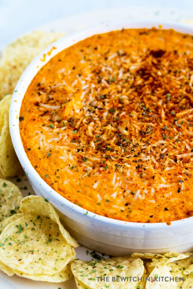 Buffalo chicken dip in a round baker with tostitos