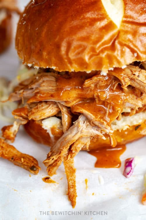 Close up of pulled pork with homemade bbq sauce dripping