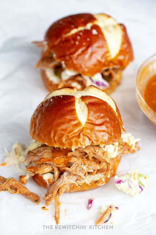 Pulled pork with homemade barbecue sauce stuffed inside a pretzel bun with homemade coleslaw.