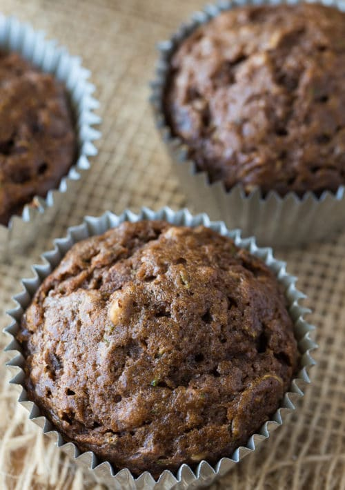 Overhead shot of chocolate muffins with pecans and zucchini.