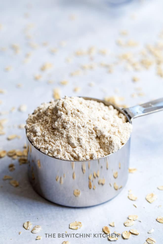 oat flour in a measuring cup