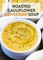 A bowl full of roasted cauliflower cheddar soup