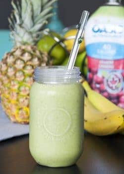 Tropical Power Smoothie - don't let the green fool you. This power smoothie is loaded with antioxidants, vitamins and protein PLUS it tastes like a tropical vacation. | The Bewitchin' Kitchen