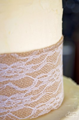 DIY wedding cake. This three tiered wedding cake is fake on the bottom and top, with two vanilla lemon cakes in the middle. Wrapped with a burlap and lace trim for a rustic wedding feel. Here's how I did it.