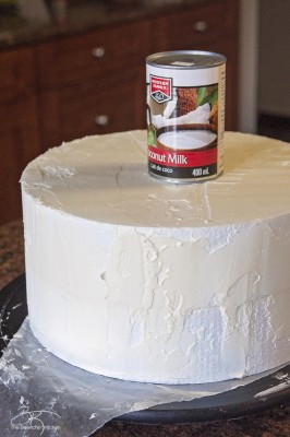 Use a soup can for your styrofoam DIY wedding cake. This three tiered wedding cake is fake on the bottom and top, with two vanilla lemon cakes in the middle. Wrapped with a burlap and lace trim for a rustic wedding feel. Here's how I did it.