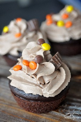 The PMS Buster - Chocolate Peanut Butter Filled Cupcakes with the world's best buttercream recipe: Chocolate Peanut Butter Frosting. Must try dessert recipe!