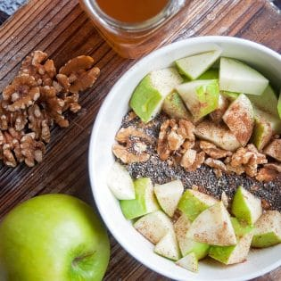 Apple Cinnamon Yogurt Bowl - a healthy snack that's delicious and on point with nutrition. Healthy snack ideas don't have to be hard, this apple recipe is high in fiber (11g) and protein! A healthy dessert that will please your sweet tooth.