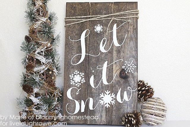12 Enchanting DIY Christmas Decor Ideas: Bring nature indoors with this DIY Woodland Sign from Live Laugh Rowe.