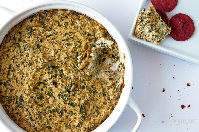 Cheesy BLT Kale Dip - This hot dip recipe is a delicious appetizer that's a party hit! Two of us cleaned the bowl faster than what I care to admit   thebewitchinkitchen.com