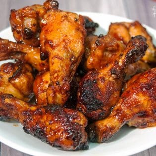 Sweet Sriracha Chicken Wings - this chicken wing recipe is the perfect blend of sweet and spicy. My husband asked me if he could go to the store, to buy more wings so I could make MORE of these tonight! Perfect for game day! | thebewitchinkitchen.com