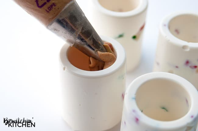 Chocolate Shot Glass with a Gingerbread Cheesecake Filling, these may be the coolest things I have ever made and they're such an easy no bake dessert too! | thebewitchinkitchen.com