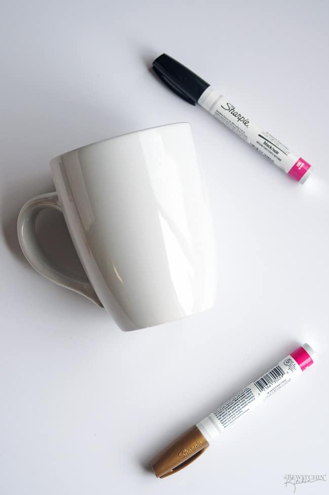 A simple and frugal DIY Engagement Gift idea! I love how easy these sharpie mugs are plus the homemade gift comes from the heart. | thebewitchinkitchen.com