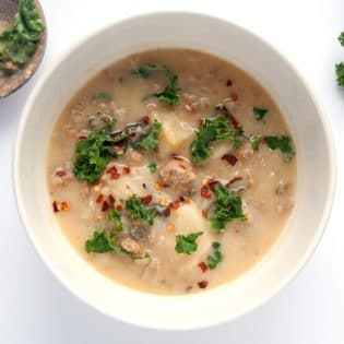 Paleo Zuppa Toscana Soup - an easy and simple paleo twist on a classic soup recipe. It's so creamy and delicious! Perfect for chilly winter nights.   thebewitchinkitchen.com