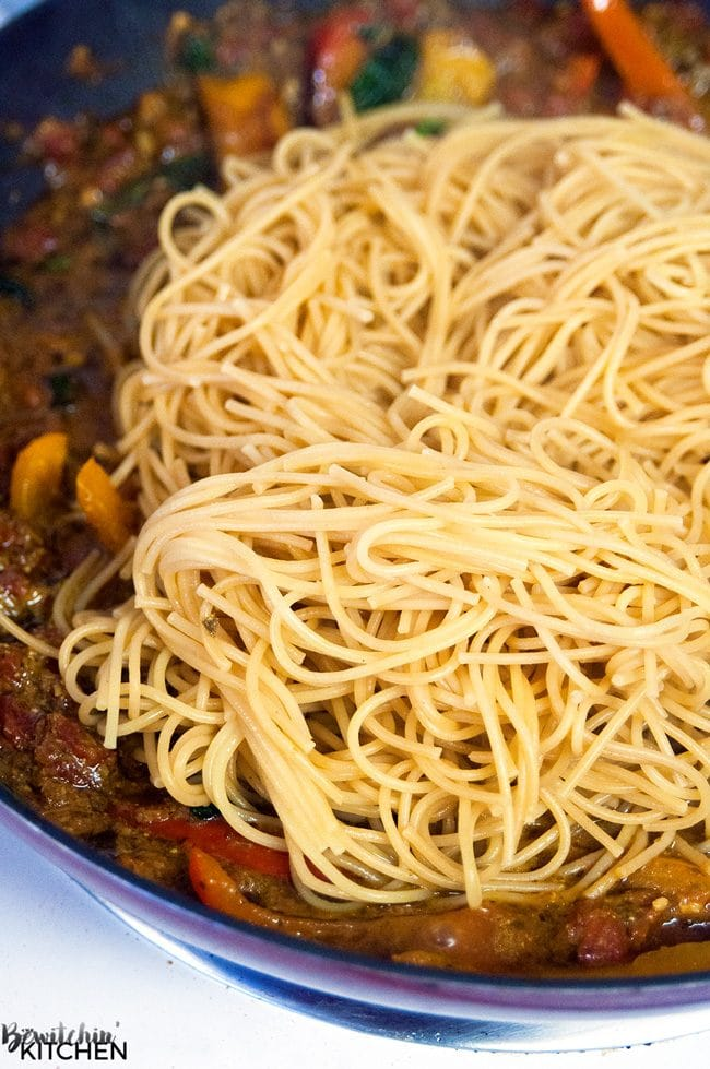 cooked pasta over sauce