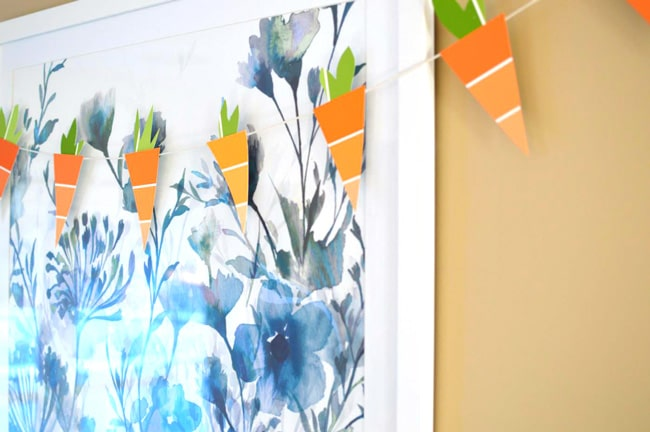 Paint Chip Spring Carrots. This Easter craft is so easy and cheap! Grab free paint chips from your local hardware store and string them up. It's an easy craft and a cute DIY! Gotta love easy paint chip crafts.