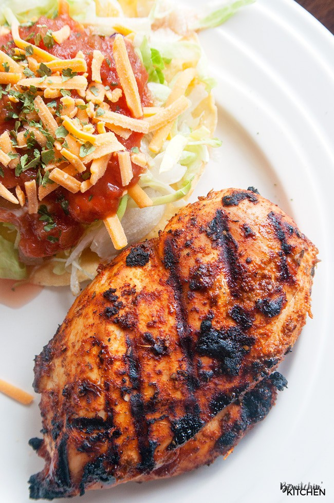 Try this recipe at your next BBQ! Barbecued Tex Mex Chicken, a healthy bbq recipe that is full on flavor! I love the southern flavors of chili, cumin and the twist with brown sugar. Serve with a tostada topped with lettuce, cheddar cheese, greek yogurt and salsa. PS - it's 21 Day Fix approved!