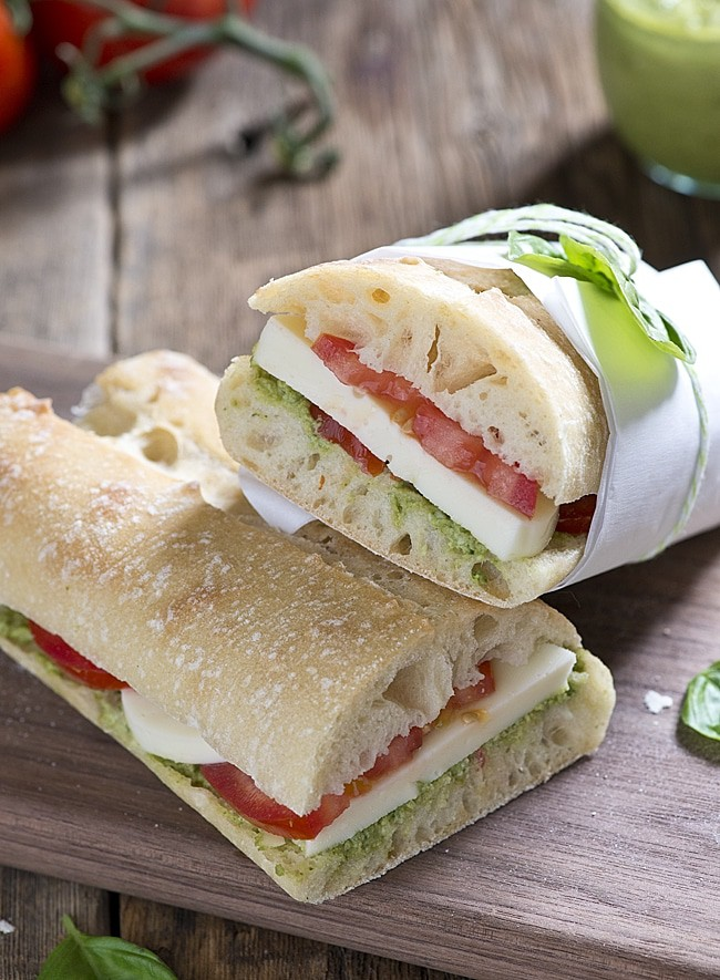 Garden Pesto Tomato Mozza Sandwich. This sandwich recipe is perfect for lunch, dinner or a snack. Using fresh tomatoes, pesto and mozzarella cheese this sandwich is a summer favorite.