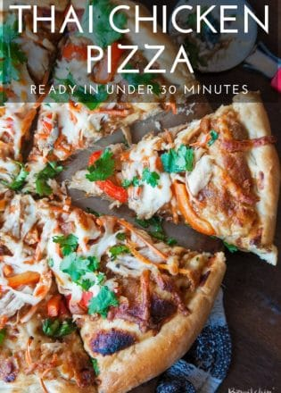 Thai Chicken Pizza - quick and easy recipe that's perfect for busy weeknights. Ready in under 30 minutes. Peanut thai sauce, chicken, carrots, cilantro and red pepper with THE BEST pizza crust recipe as a base.