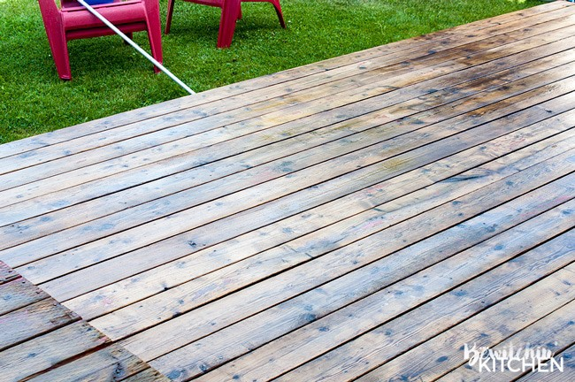 How to stain a deck in 4 easy steps. This DIY deck renovation uses Behr's Premium Deck Stripper, Wood Cleaner and Semi-Transparent Stain in Redwood Naturaltone. The before and after looks incredible!