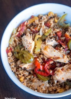 Quick and easy spanish rice bowls using grilled chicken, banana peppers, sundried tomatoes and Seeds of Change Spanish Rice.