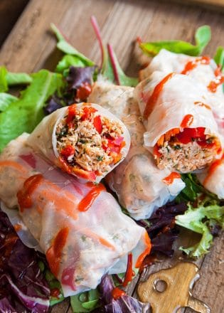 Honey Sriracha Chicken Spring Rolls - this slow cooker dinner recipe uses rice paper wrappers and is not only gluten free but paleo and 21 day fix approved as well. | TheBewitchinKitchen.com