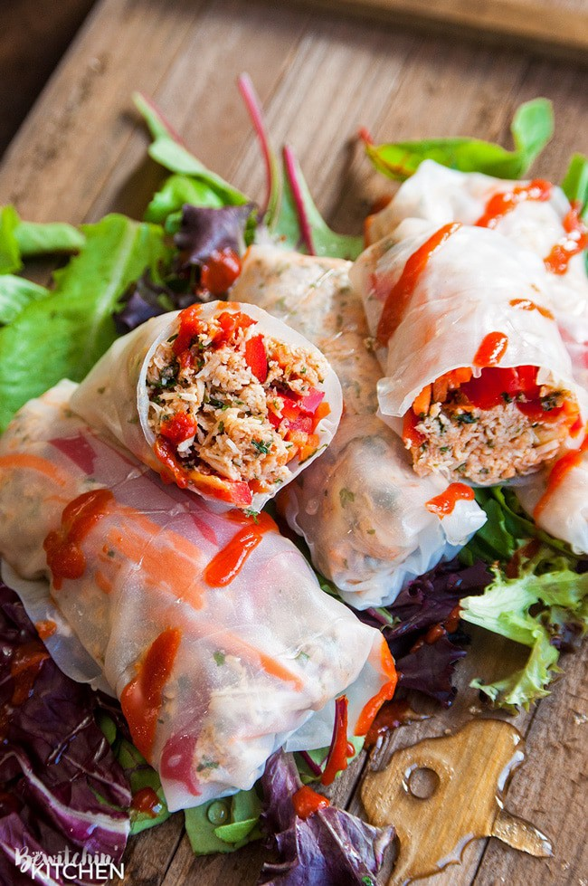 Honey Sriracha Chicken Spring Rolls - this slow cooker dinner recipe uses rice paper wrappers and is not only gluten free but paleo and 21 day fix approved as well.   TheBewitchinKitchen.com