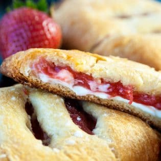 Strawberry Rhubarb Hand Pies. These cream cheese filled strawberry rhubarb turnovers only have three ingredients. Super easy dessert recipe!