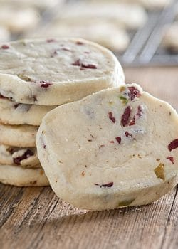 These Brown Butter Cranberry Pistachio Icebox cookies are a breeze to make for any dessert table! Buttery, rich and loaded with cranberries and pistachios!
