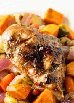 Cranberry balsamic chicken breasts with roasted vegetables. A healthy dinner recipe that uses up leftover cranberry sauce!