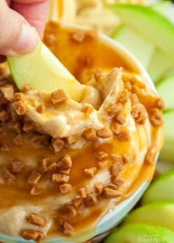 Peanut Butter Dip - calling all peanutbutter lovers! This creamcheese dessert dip is heaven on earth. Goes great with apples or shortbread cookies. I love the crunch of the skor topping too. So darn good! | thebewitchinkitchen.com