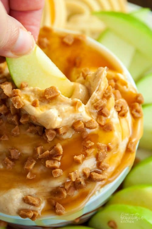 Peanut Butter Dip - calling all peanutbutter lovers! This cream cheese dessert dip is heaven on earth. Goes great with apples or shortbread cookies. I love the crunch of the skor topping too. So darn good! | thebewitchinkitchen.com