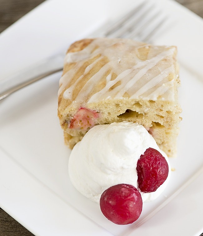 Cherry Oat Breakfast Cake recipe. Cake for breakfast? Yes! This is an easy recipe for a slightly sweet breakfast cake full of wholesome oats, fresh or frozen fruit and finished with a simple glaze.