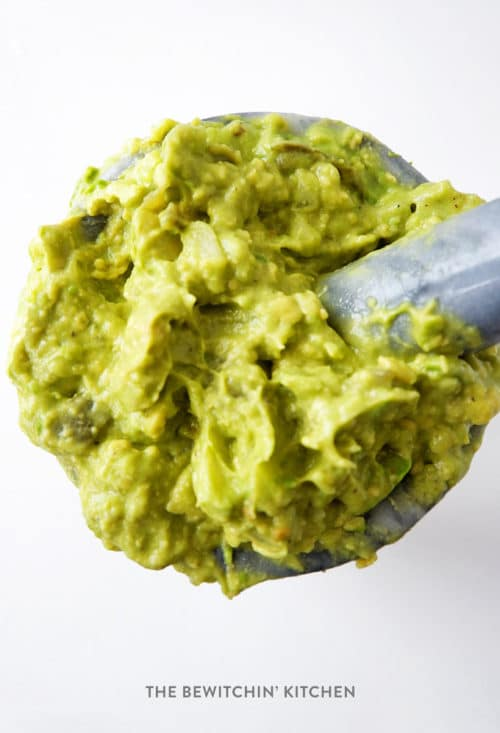 authentic guacamole recipe mashed together in a mortar and pestle.
