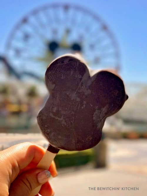 Mickey shaped ice cream at California adventure in front of Mickey's Fun Wheel