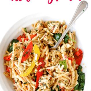 Spicy asian pasta salad recipe - a delicious cold pasta salad recipe with an asian dressing with sesame oil, chili flakes, chili paste, garlic and more.