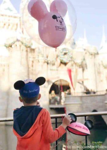 Disneyland Pregnancy Announcement. It's a girl! A fun way to announce a pregnancy at Disney and a Disney gender reveal!