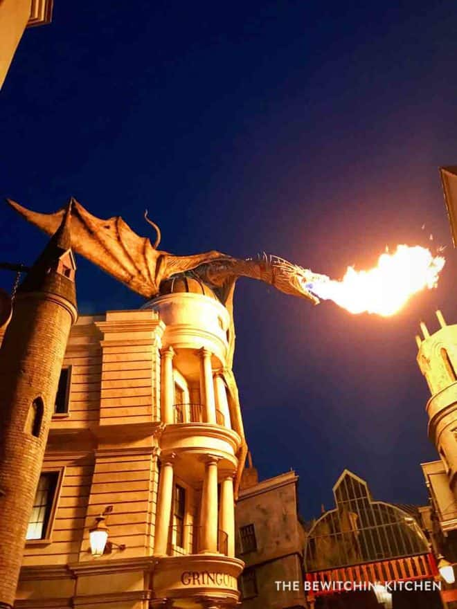 Dragon breathing fire over Gringotts bank at Universal Orlando Resort