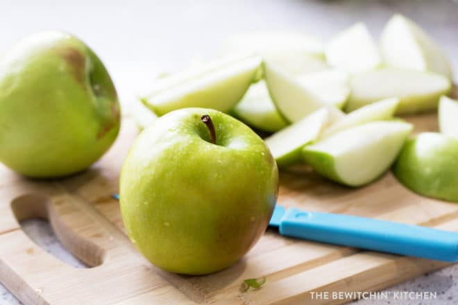 granny smith apple on a cutting board