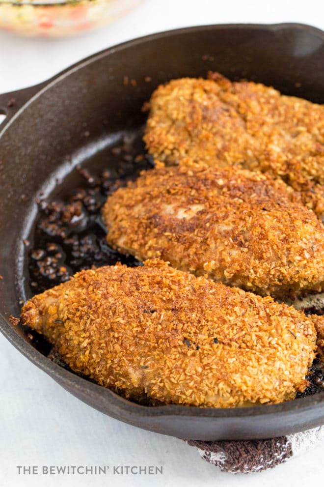 Coconut Crusted Chicken in a cast iron Pan