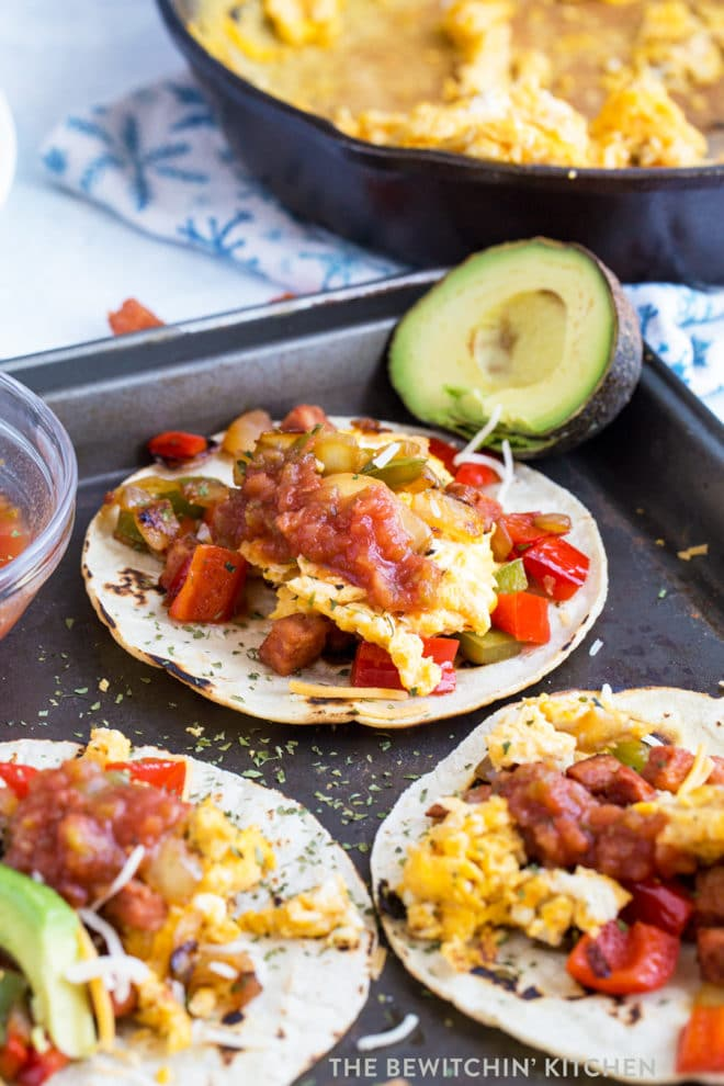 Corn tortillas with eggs and chorizo on a baking sheet