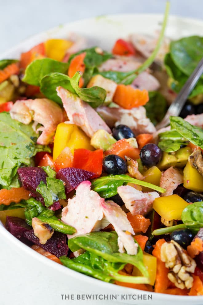 Rainbow salad with fruits, chicken, and vegetables.