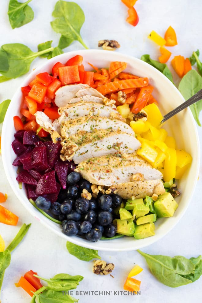 Sliced chicken breast over a rainbow of fruit and vegetables topped with key lime vinaigrette.
