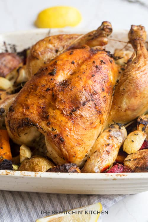 Roast chicken over a bed of vegetables