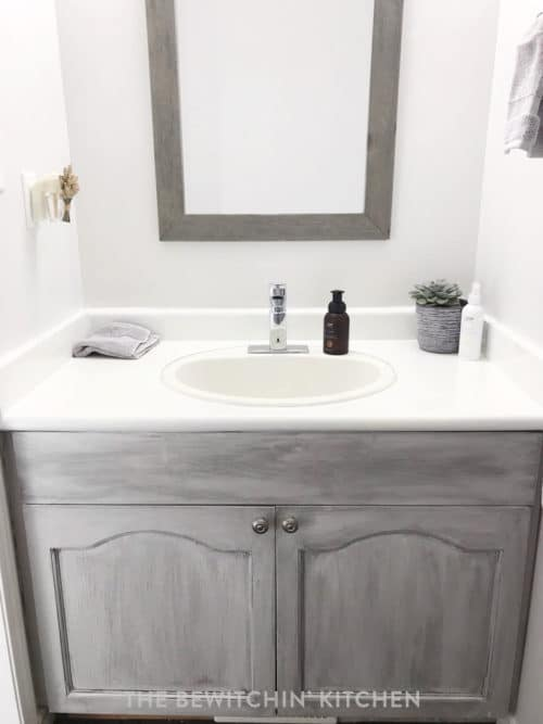 Beautiful small bathroom remodel with painted oak cabinets and Rustoleum painted countertop.