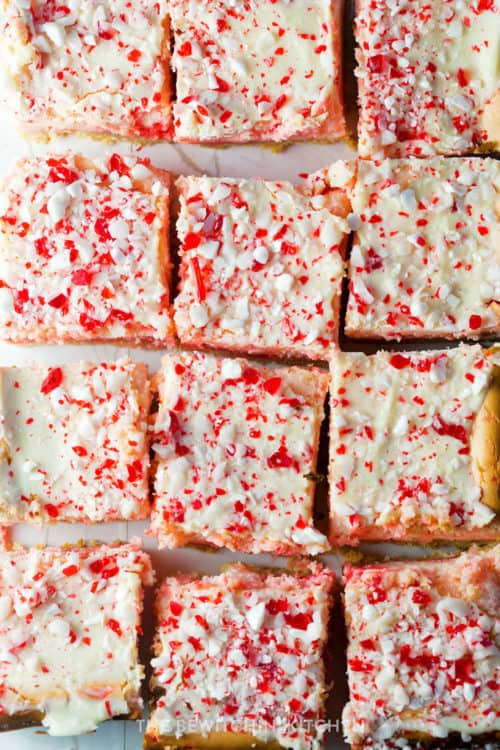 Peppermint white chocolate cheesecake bars cut into squares