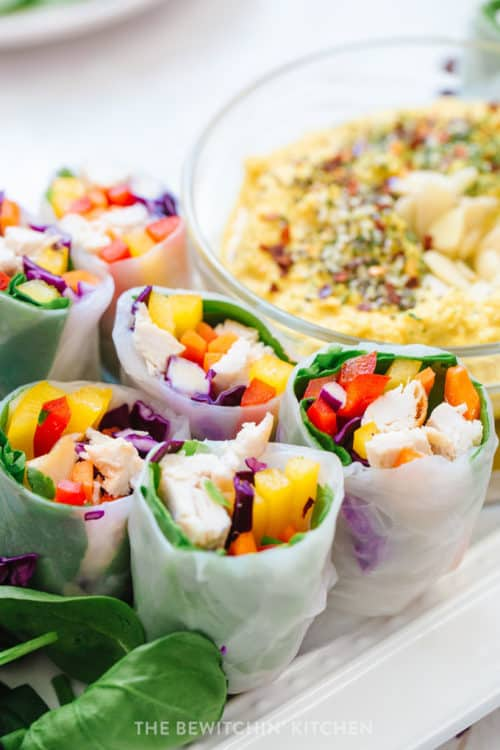Rice paper wrapped chicken and rainbow vegetables with a dairy free dipping sauce.
