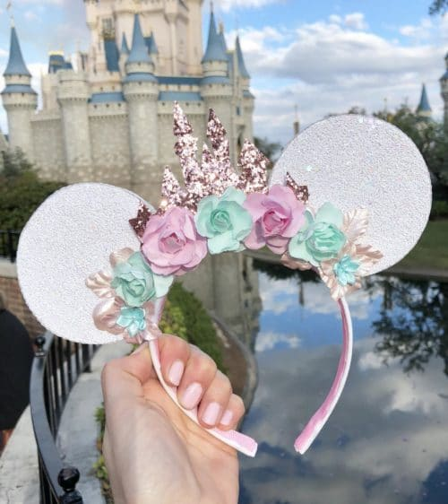 Castle rose gold minnie mouse ears with Cinderalla's castle in the background
