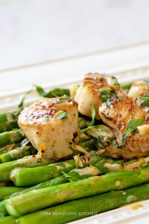 Seared scallops over a bed of asparagus