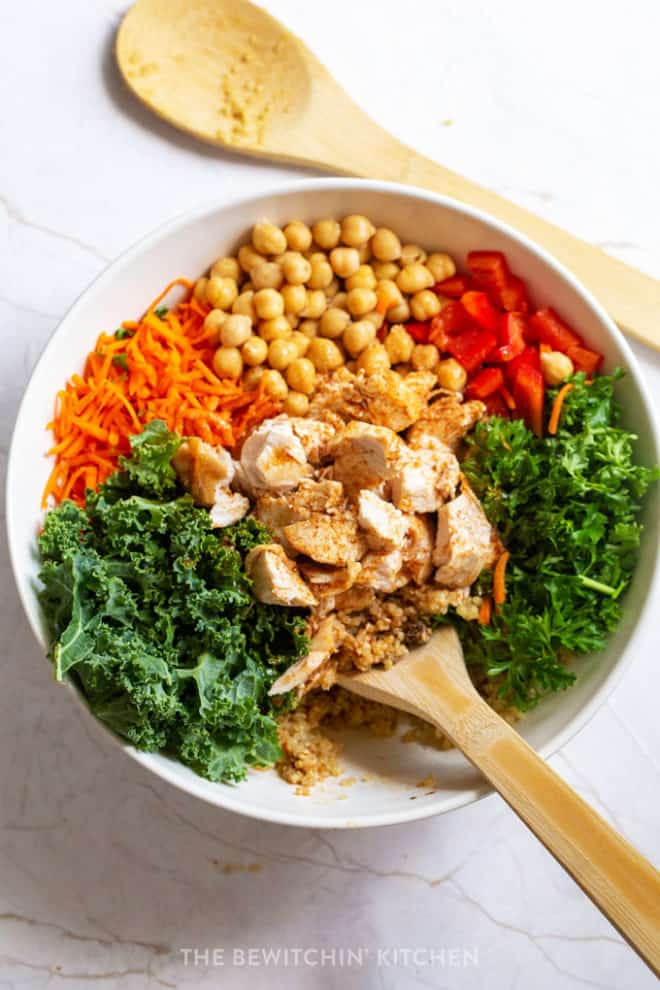 Kale carrot salad bowl dressed with a moroccan vinaigrette.