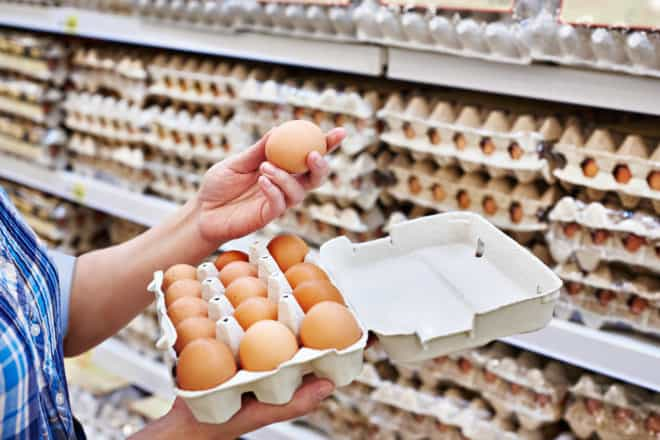 checking out eggs in the grocery store